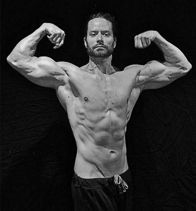 Brad Pilon Flexing Biceps
